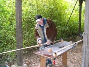 Markus Erdmann crafting a wooden longbow