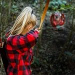 woman shooting at a 3d archery target