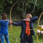 Woman shooting the longbow