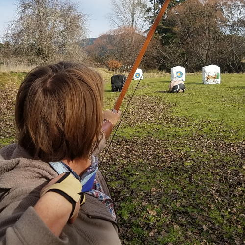 Female Archer Denise shooting her longbow