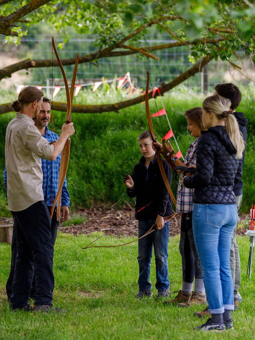 Tour participants learn how to shoot the longbow