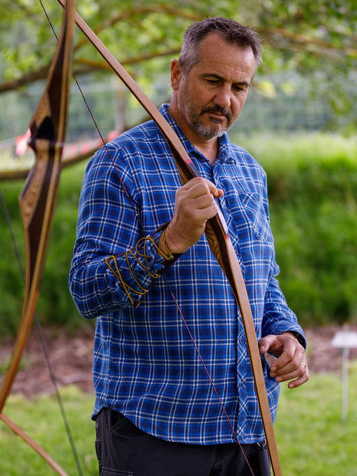 Man checking out a traditional longbow at Archery Park Nelson