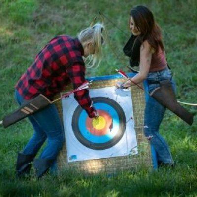 Archery Park Nelson beginner training pulling arrows from target